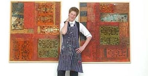 Prince Harry flanked by his artwork