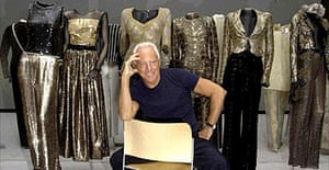 Giorgio Armani with some of his designs at the RA