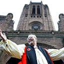 The dean of Liverpool Cathedral, Rev Rupert Hoare, celebrates its £83,000 grant from English Heritage