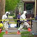 The FBI's hazardous materials response team entering the home of artist Steven Kurtz