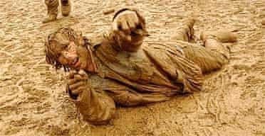 Glastonbury festivalgoer revels in the mud, 2004