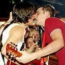 Carl Barat and Pete Doherty performing at an impromptu gig in Chatham, Kent