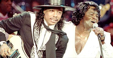 Rick James performing with James Brown in 1991