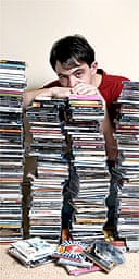 Alexis Petridis with piles of CDs