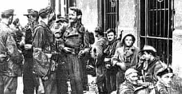 Jerzy Tomaszewski's photo of fighters in Warsaw preparing for action on August 1 1944