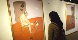 An Iranian woman looks at a Francis Bacon painting