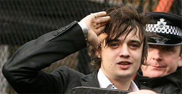 Pete Doherty leaves Ealing magistrates court after being sentenced to 12 months community service for drug possession