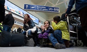 Stranded Malev passengers wait for information at Budapest airport