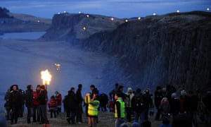 Volunteers carrying flaming torches light the route of Hadrian's Wall