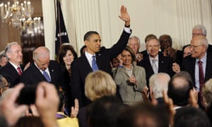 US President Barack Obama signs the health insurance reform bill in the East Room