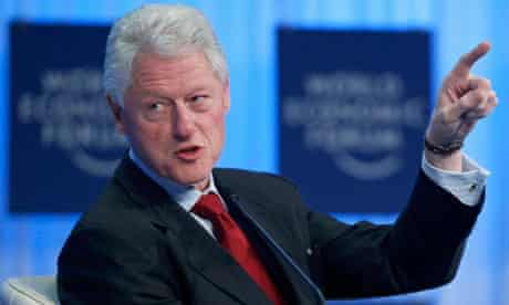 Former U.S. president Bill Clinton attends a session at the WEF in Davos