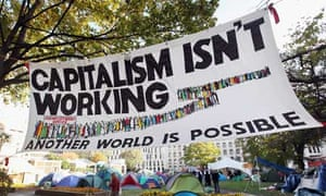 A banner reading 'Capitalism isn't working' at the Occupy London Stock Exchange protest