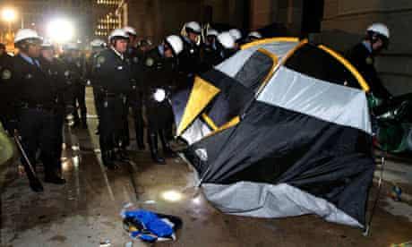 Police officers clear the Occupy Philadelphia encampment