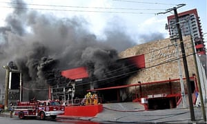 Thick smoke billows from the Casino Royale as firefighters attack the fire in Monterrey, Mexico