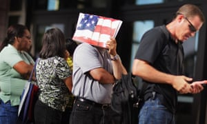 Americans wait in line to get mortgage advice on foreclosures