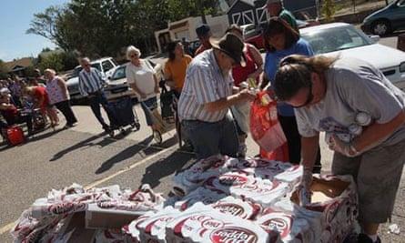 Volunteers hand out free groceries to locals in Pueblo, Colorado