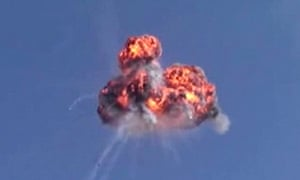 Video purports to show a Syrian army helicopter being shot down in the Syrian province of Idlib