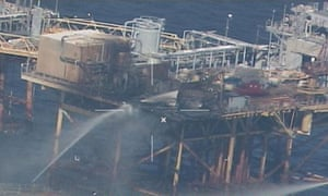 A coast guard image shows vessels extinguishing the fire on the Black Elk Energy platform