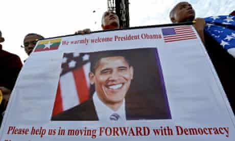 Buddhist monks hold a placard to welcome US President Barack Obama at Yangon international airport
