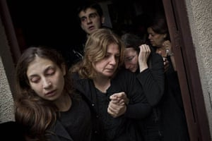 Palestinian mourners cry during the funeral of Salem Paul Sweliem during his funeral in Gaza City