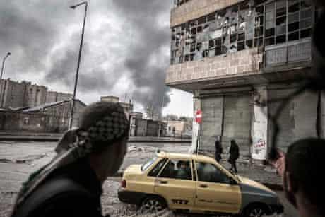 Smoke rises from the Karmal Jabl neighborhood