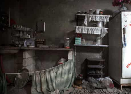 A damaged kitchen inside a residential house