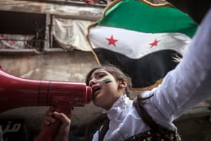 A Syrian girl chants slogans during a demonstration after Friday prayers