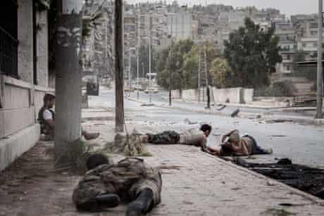 Free Syrian Army fighters crawl on the sidewalk