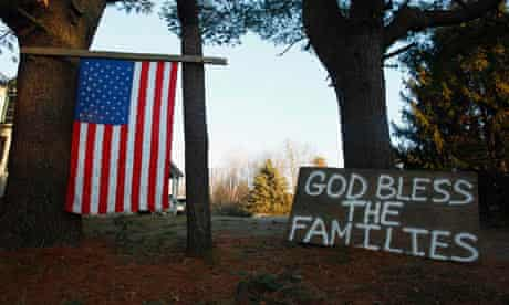 A sign and a US national flag are seen near Sandy Hook Elementary School