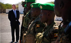 British Foreign Secretary William Hague chats with Ugandan soldiers in Somalia