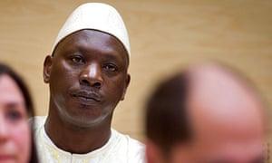 Thomas Lubanga sits in the International Criminal Court