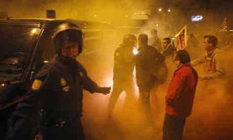 Police try to escort a truck leaving a food warehouse past picketers in Malaga, southern Spain