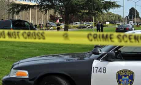 Police officers cordon off the site of a school shooting at Oikos University in Oakland