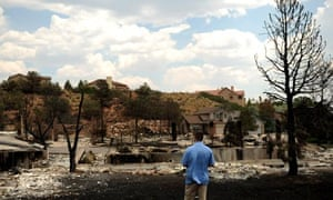 A secret service agent looks over homes in Colorado Springs burned by the Waldo Canyon fire