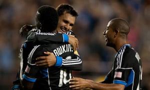 415a2130bbd San Jose Earthquakes  Chris Wondolowski celebrates with teammate Simon  Dawkins