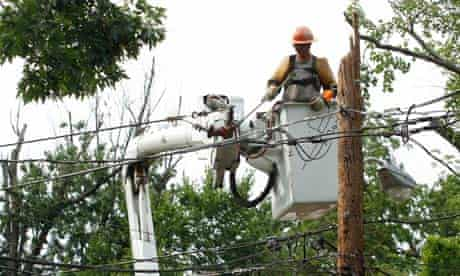 A Pepco contract worker works on a damaged utility pole in Silver Spring, Maryland