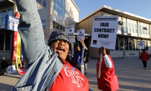 Chicago teachers walk a picket line outside Benjamin Banneker elementary school in Chicago