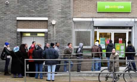 A queue of job seekers outside a job centre in North London this morning. unemployment unemployed