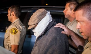 Nakoula Basseley Nakoula is escorted from his home by LA police officers