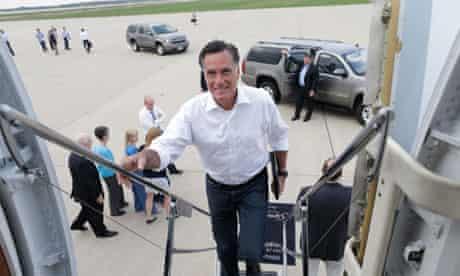 Mitt Romney boards his charter plane in Kansas City