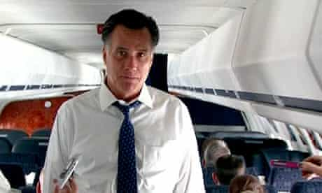 Mitt Romney speaks to the press onboard his campaing plane