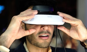 An attendee uses a Sony personal 3D viewer at CES