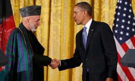 Karzai and Obama shake hands