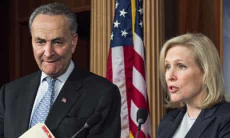 New York Senators Charles Schumer (L) an
