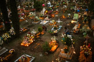 People visit a cemetery at San Gregorio de Atlapulco on the Day of the Dead