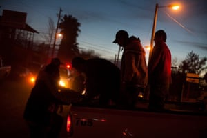 Men arrested by the police are prepared for processing at a small jail in Nogales, Sonora