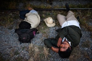 Two men sleep next to the train tracks on Arriaga, Chiapas