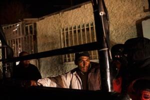 Police in Ciudad  Juárez frisk a man during a security sweep