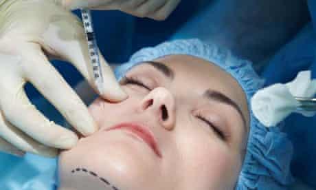 Young woman having facial plastic surgery