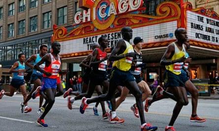 Dennis Kimetto of Kenya runs through the streets during the Chicago marathon